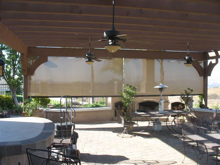 pergola with valence drop down screens and a ceiling fan with a bar
